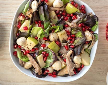 Salada de romã, maçã e cogumelos